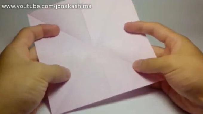 Making an origami flower this is a tutorial video that will show you how to make origami flower start by folding the square shaper paper in half and make a crease then the other mightylinksfo
